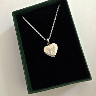 Silver heart shaped disc necklace